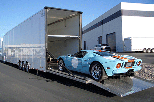 Muscle car being shipped in an enclosed truck