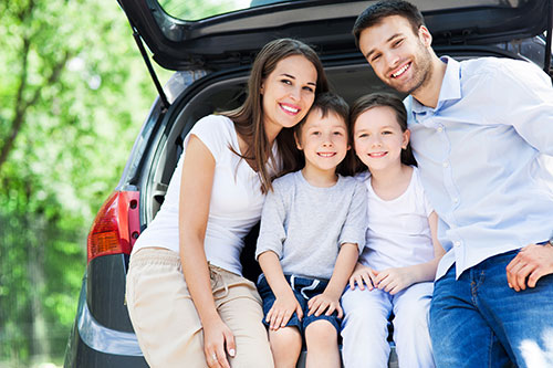 Family accepting car delivery in Nashville